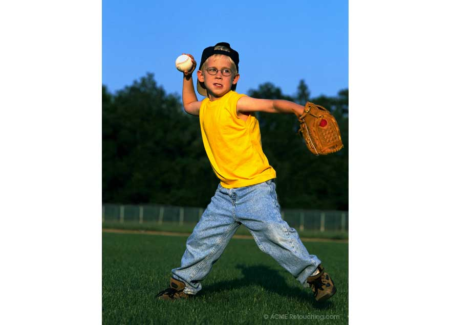 Photo retouching of young boy throwing baseball removed bags from